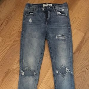 distressed blue light washed jeans from garage